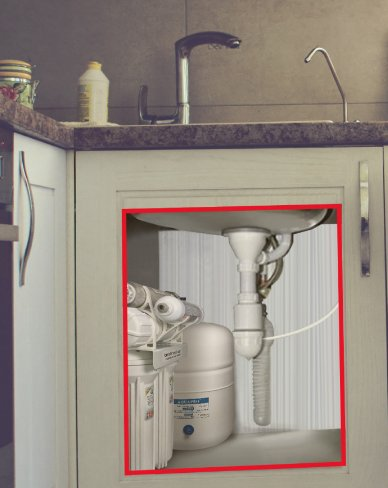 Reverse osmosis filter fitting into kitchen under the sink
